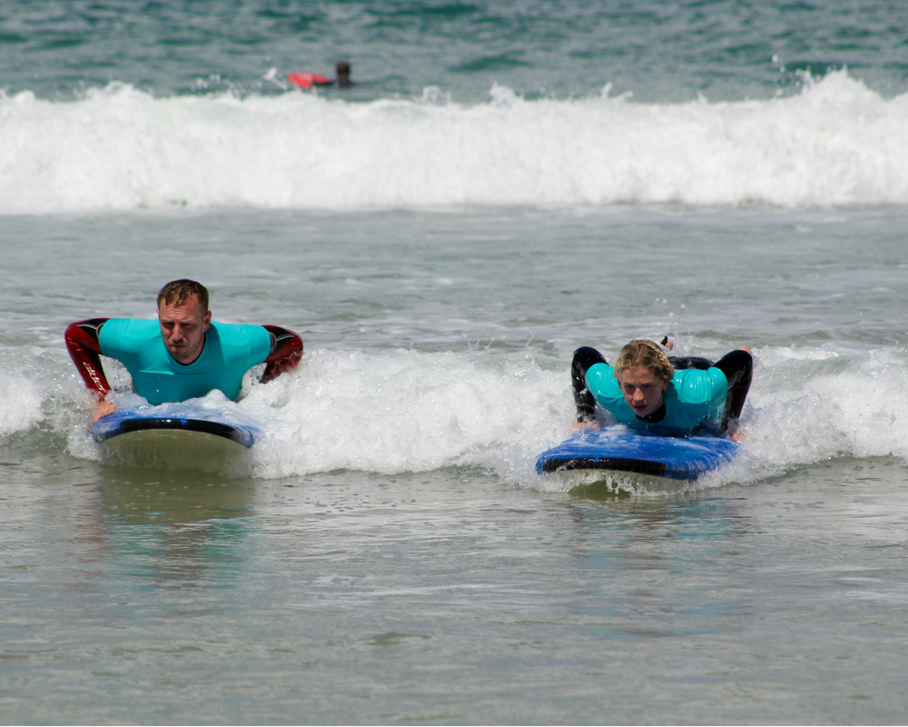 two guests surfing cornwall yoga retreat