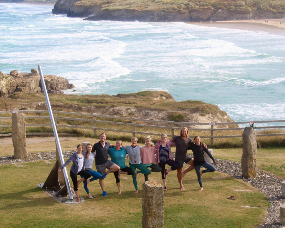guests tree pose group photo cornwall
