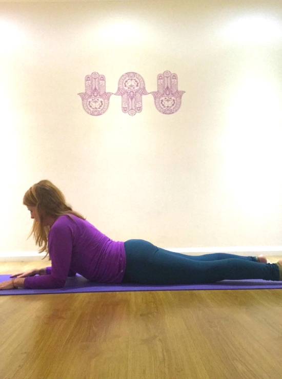 sphinx yoga pose lie on floor sit up on forearms yin yoga pose
