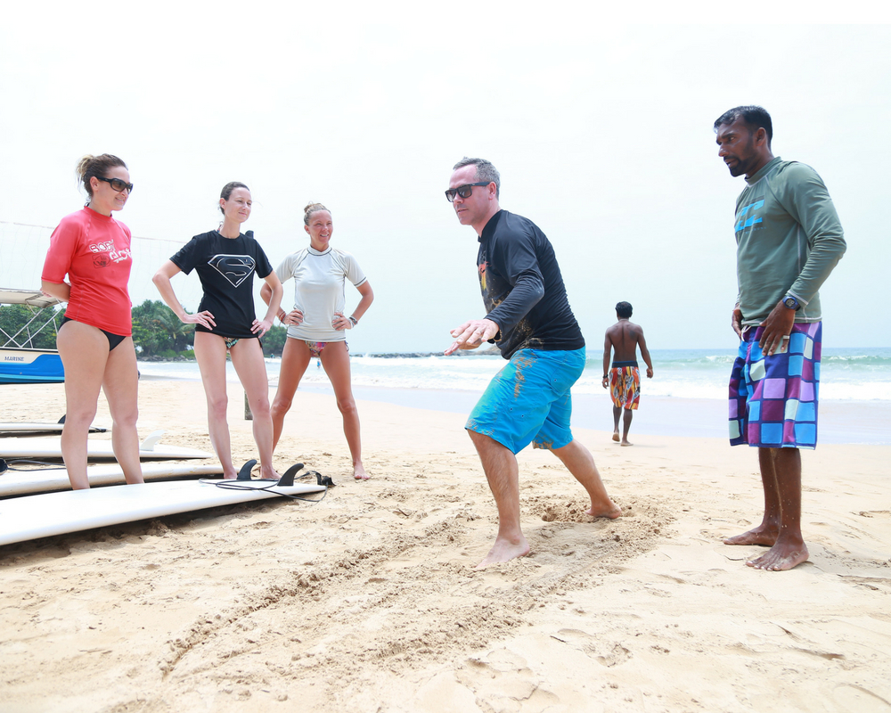 surf-lesson-beach-guests-teacher-beach-sri-lanka