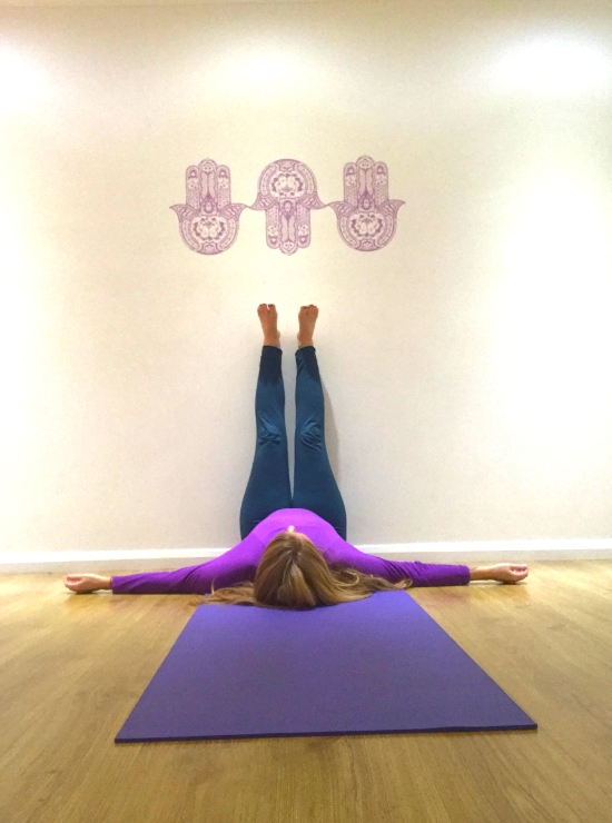 legs up the wall yin yoga pose ease back pain