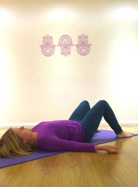 constructive rest ease back pain yin yoga pose lie on back bent knees