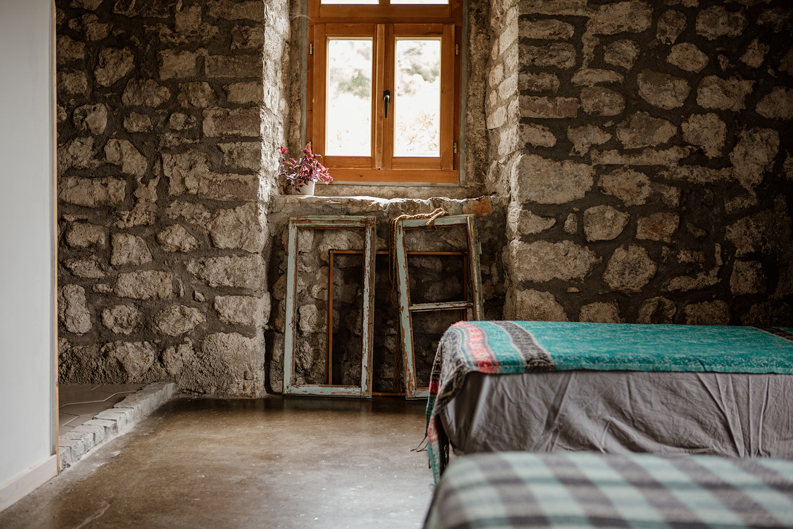 single bed ends window brick wall - hiking yoga holiday montenegro