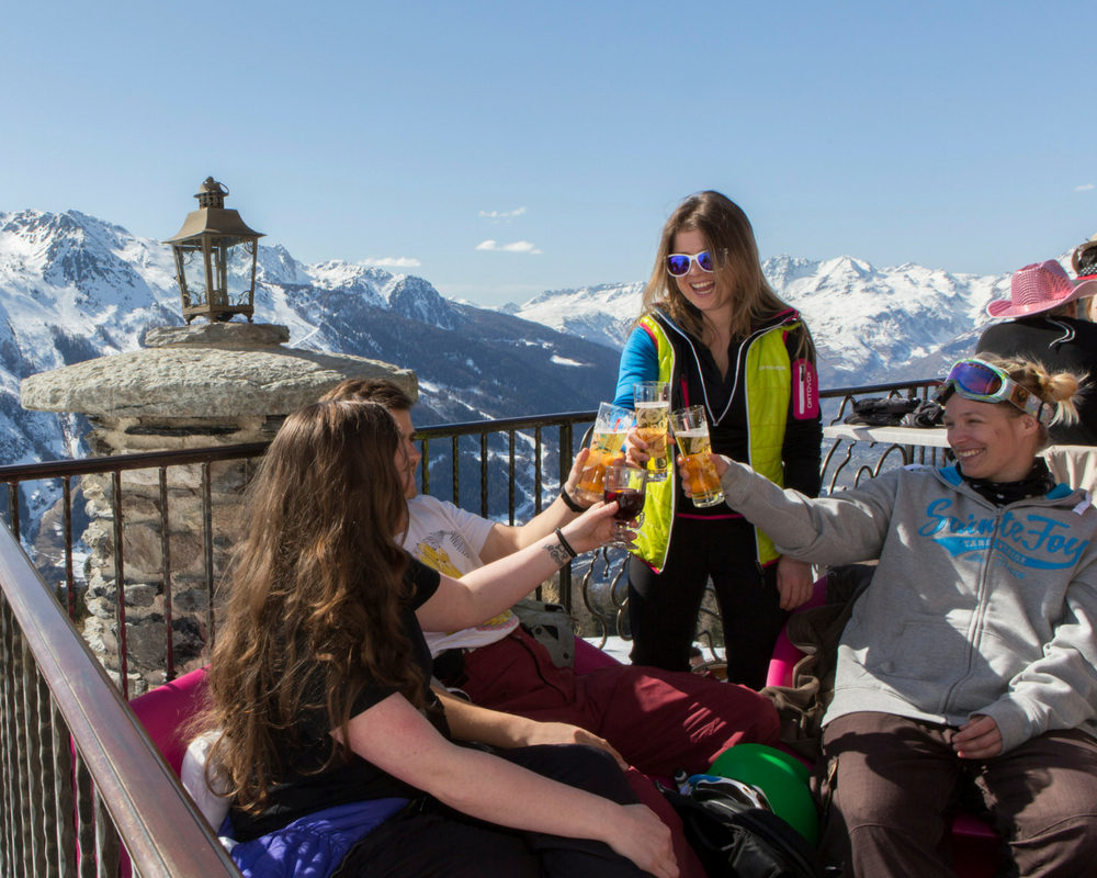 People having a drink on mountain bar