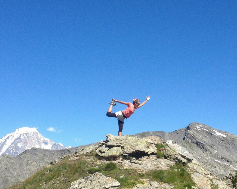 Yogi pose on top of mountain