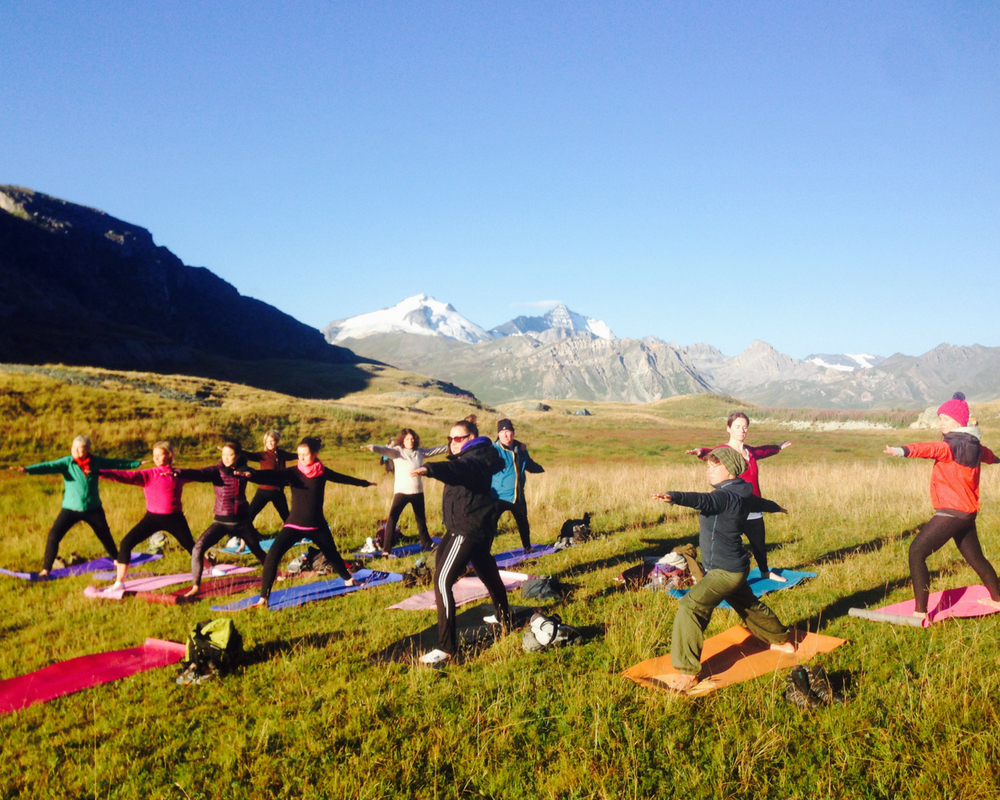 Yoga practice on top of mountain