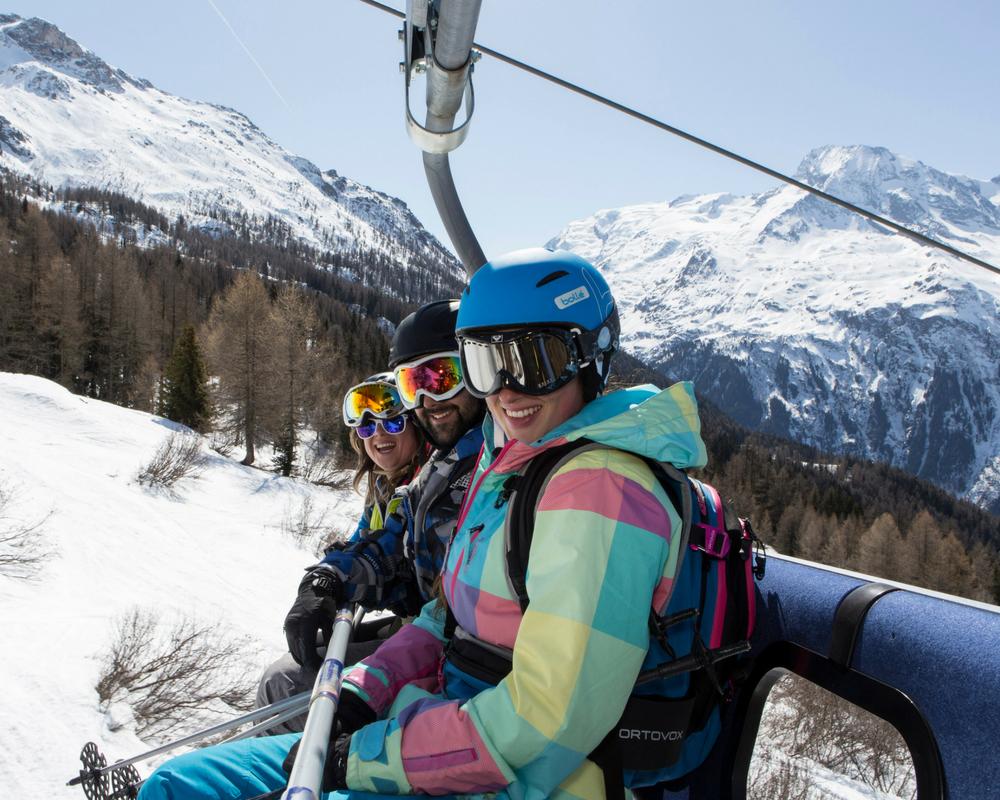 Three people on ski lift