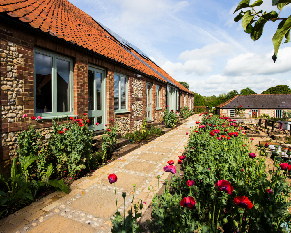 Exterior of yoga retreat with poppies - august bank holiday yoga retreat norfolk