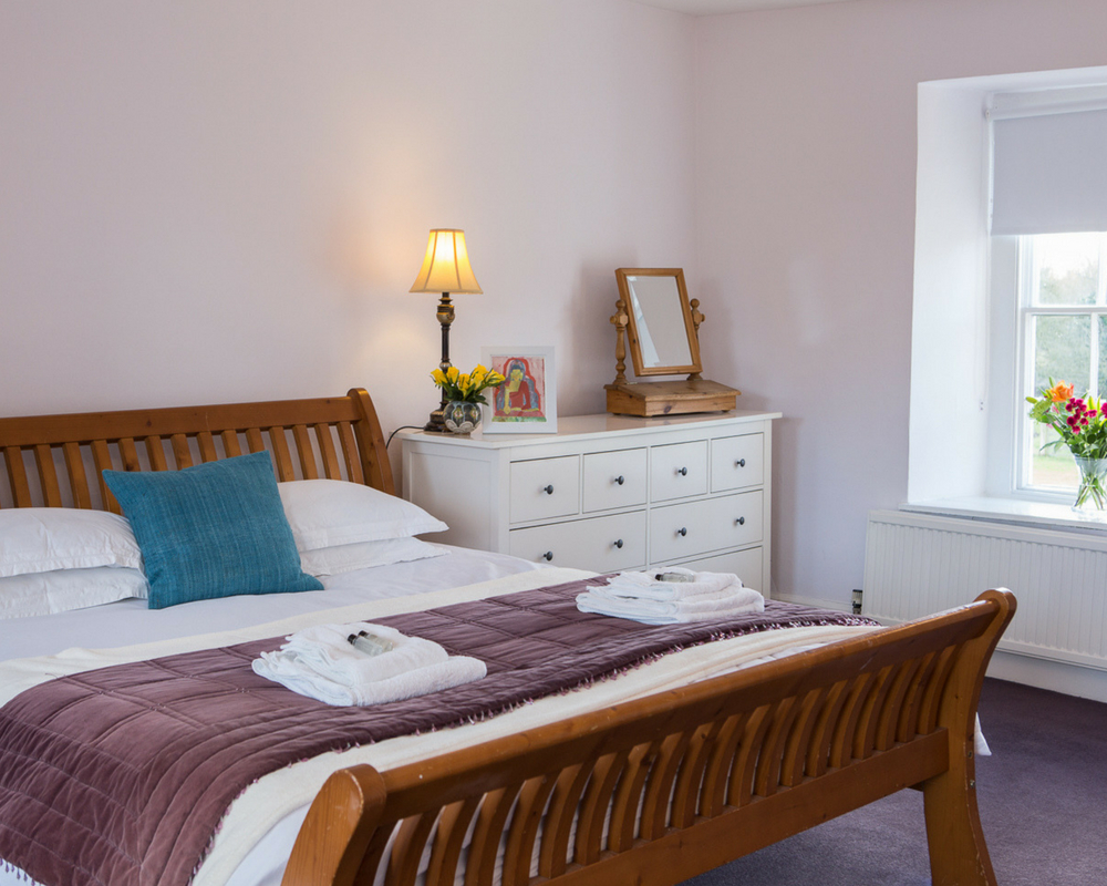 Bed and side table with lamp yoga retreat thrupp