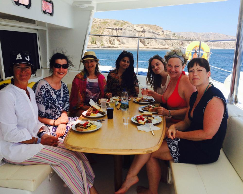 Yogis having lunch on catamaran