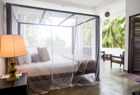 Sri-Lanka-Jasper-house-open-air-bed-veiw-palms-sunshine-surf-beach-yoga-holiday