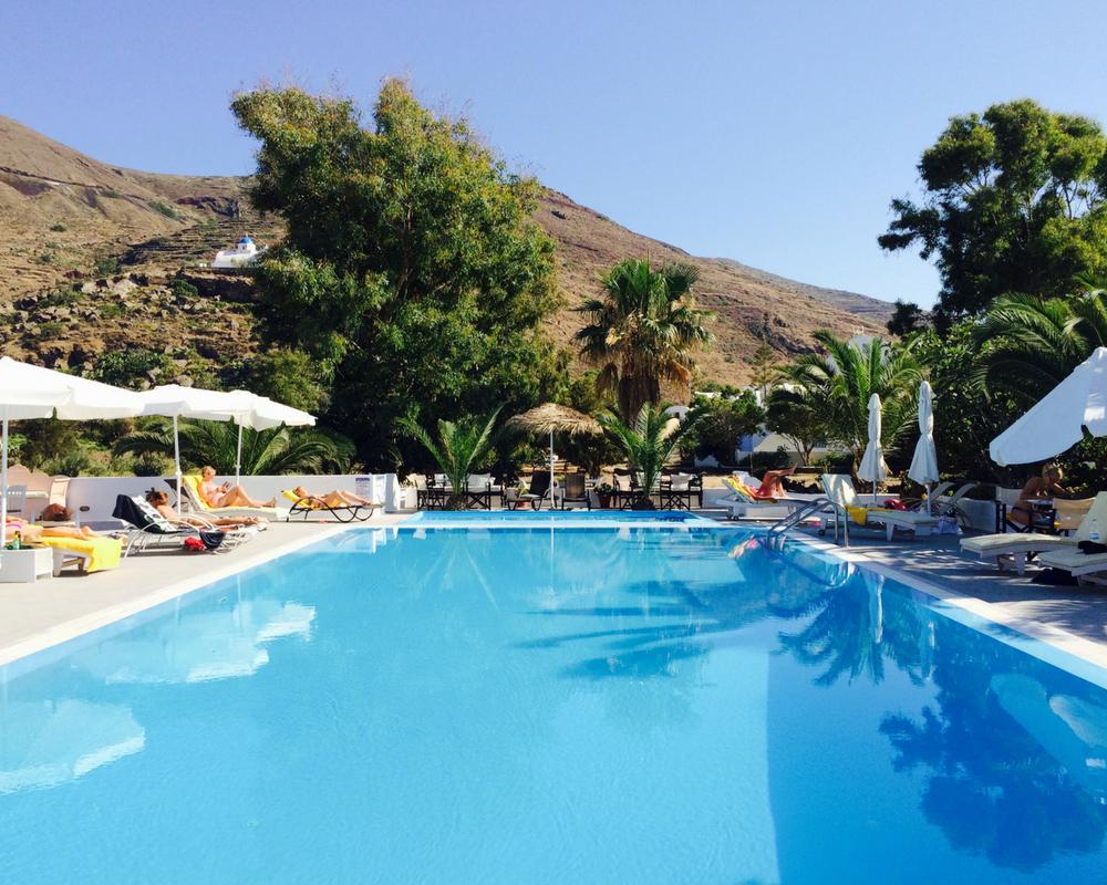 swimming pool sunshine and yoga holiday santorini greece