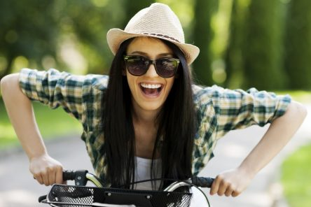 girl - happy - bike - santosha