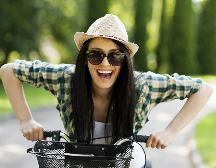 girl - happy - bike - santosha