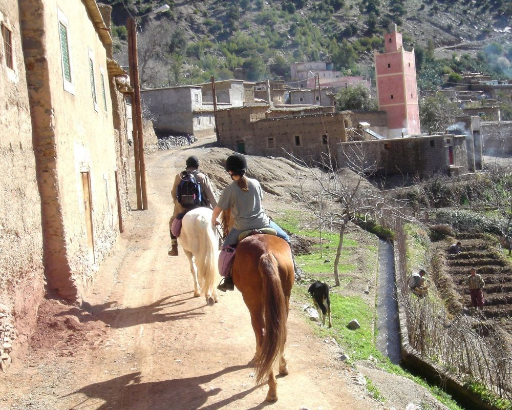 two girls horse riding atlas mountains