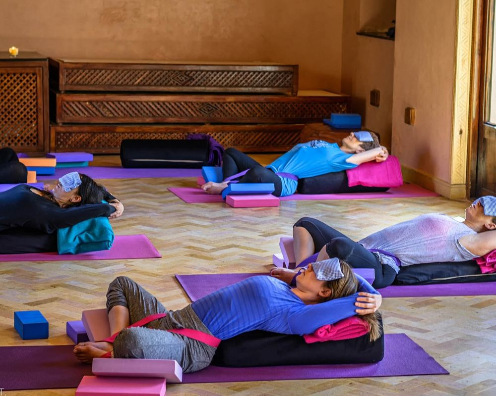 people in restorative supported savasana