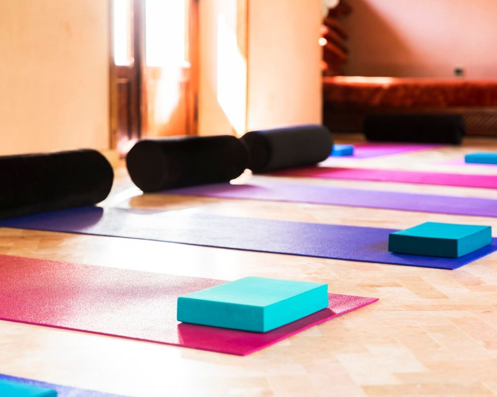 yoga mats bolsters blocks in yoga shala