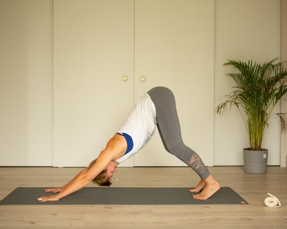 bent knee downward dog self-limiting beliefs yoga practice