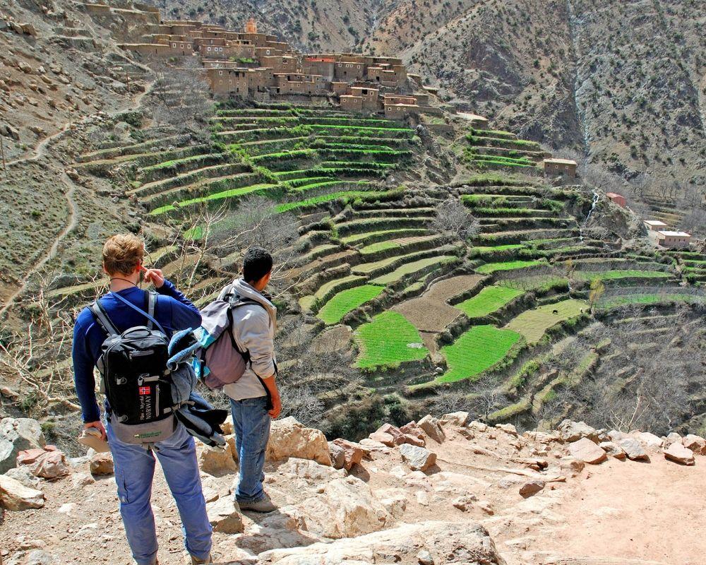 two men hiking atlas mountains tiered farming
