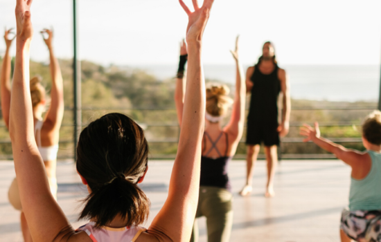 roof top yoga class with people yoga holiday costa rica