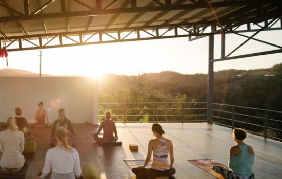 yoga class in shala at sunset yoga holiday costa rica