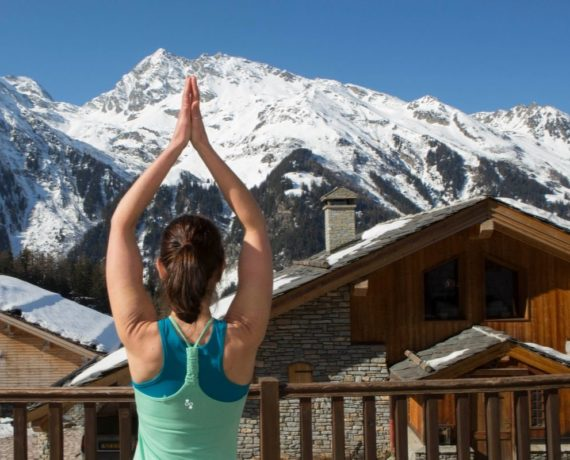tree pose arms mountain views skiing yoga holiday french alps