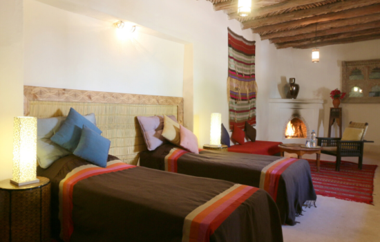 twin beds and seating area yoga holiday Marrakech