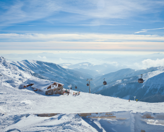 view of mountains in sunshine -mountain restauarant - jasna skiing and yoga holiday