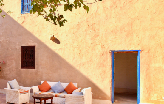 sofa and cushions in morrocan style courtyard yoga holiday Marrakech