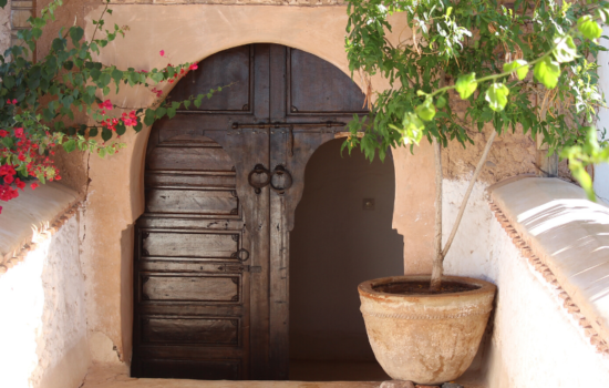 moroccan style door, walls and plant pots yoga holiday Marrakech