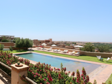 outdoor pool, sun loungers and views yoga holiday Marrakech