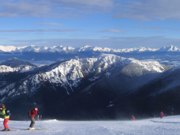 jasna ski area and skiers in foreground