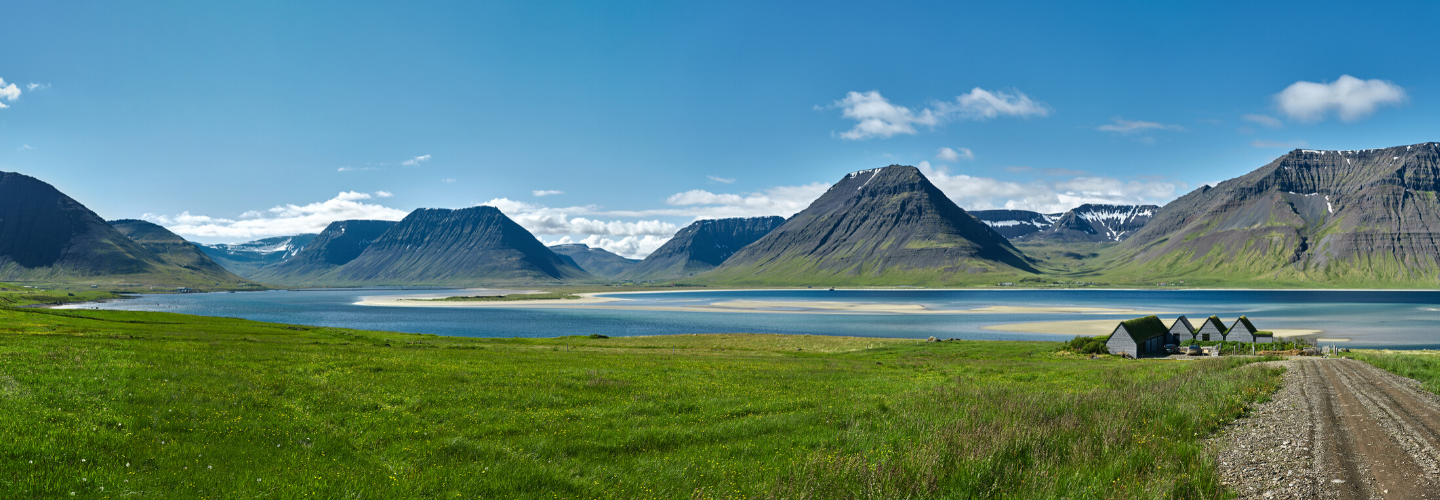 Iceland summer landscape mountains, lake, houses