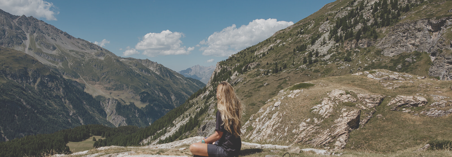girl meditating in mountains